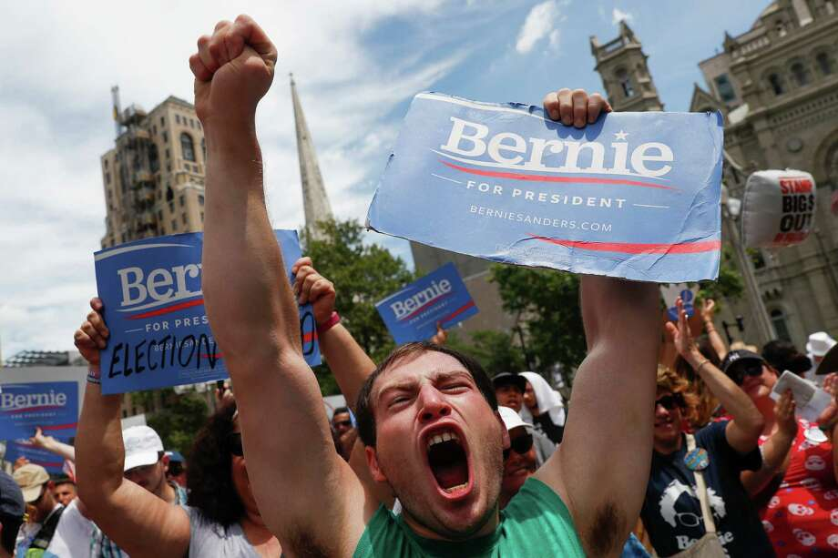 Supporters of Sen. Bernie Sanders make their feelings known at a rally in Philadelphia on July 26, during the second day of the Democratic National Convention. The low favorability rates of both major party candidates makes this a difficult election to call. Photo: John Minchillo /Associated Press / AP