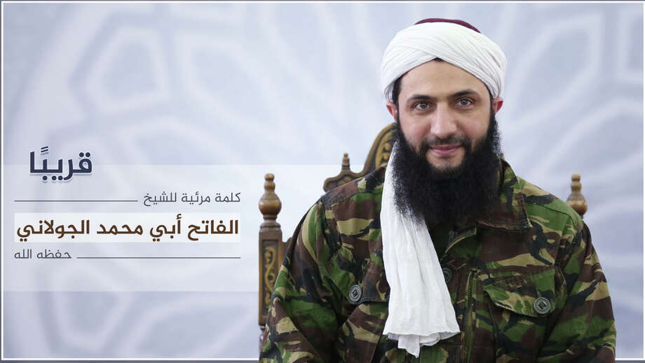 "Nusra Front leader Mohammed al-Golani undated photo released online on Thursday, July 28, 2016 to announce a video message that the militant group is changing name, and claims it will have no more ties with al-Qaida. In a video aired on the Syrian opposition station Orient TV and Al-Jazeera  al-Golani said the delinking from the terror network aimed to remove ""pretexts"" by the U.S. and Russia to strike other rebel groups while claiming they are targeting Nusra. Arabic reads, ""coming soon, a video by the conqueror, Mohammed al-Golani.""  (militant photo via AP) Photo: HONS / militant photo"