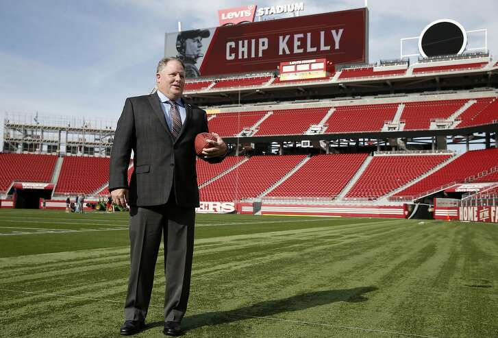 Chip Kelly steps onto the Levi's Stadium turf after being introduced as the new head coach of the San Francisco 49ers in Santa Clara, Calif. on Wednesday, Jan. 20, 2016.