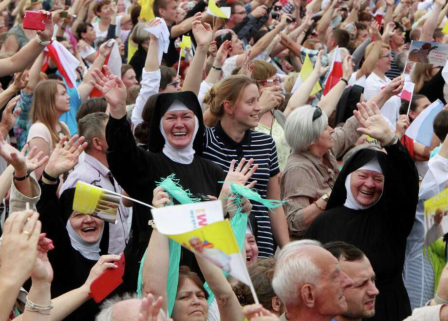 Faithful cheer Pope Francis  in front of the Jasna Gora shrine in Czestochowa, Poland, Thursday, July 28, 2016. (AP Photo/Czarek Sokolowski) Photo: Czarek Sokolowski, STF / Copyright 2016 The Associated Press. All rights reserved. This material may not be published, broadcast, rewritten or redistribu