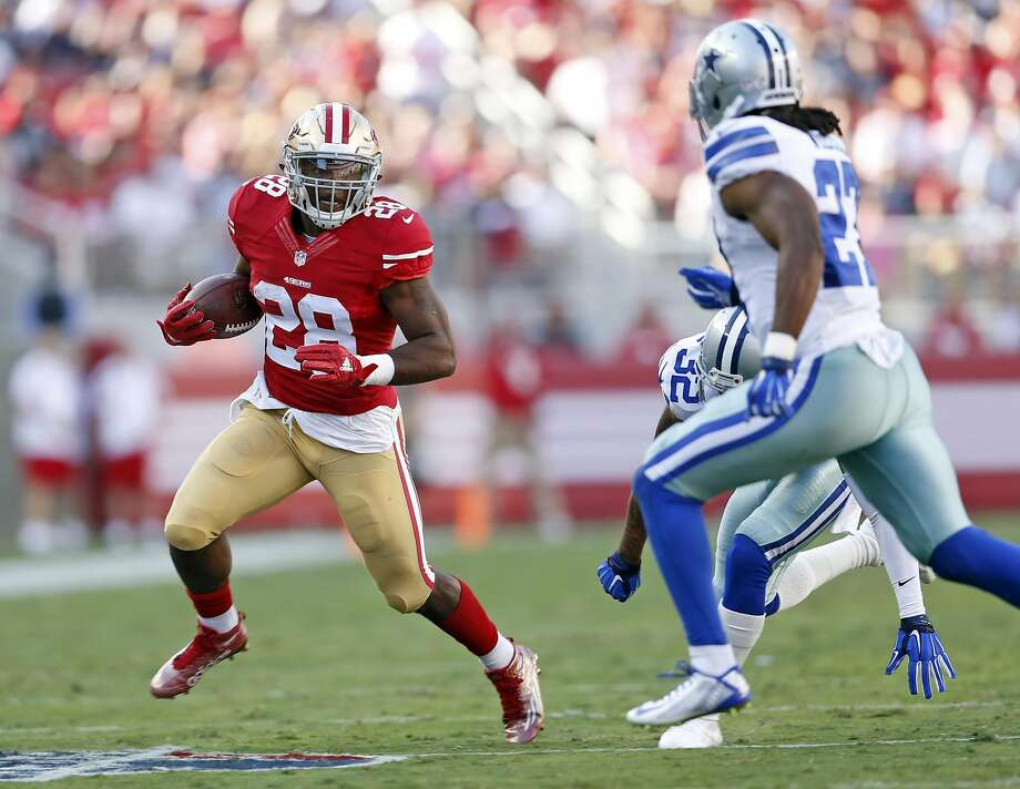 San Francisco 49ers' Carlos Hyde rushes against the Dallas Cowboys in 1st quarter during NFL preseason game at Levi's Stadium in Santa Clara, Calif., on Sunday, Aug. 23, 2015. Photo: Scott Strazzante, The Chronicle