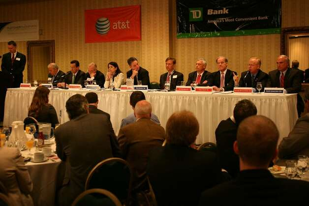 Candidates face off in the Governor Candidates' Forum debate at the Holiday Inn in Bridgeport, Wednesday morning, April 28, 2010. From left are Connecticut Post moderator Ken Dixon, and candidates Michael Fedele (R-Stamford), Dan Malloy (D-Stamford), Larry DeNardis (R-Hamden), Mary Glassman (D-Simsbury), C. Duffy Acevedo (R-Branford), Ned Lamont (D-Greenwich), Oz Griebel (R-Simsbury), Tom Foley (R-Greenwich), Mark Boughton (R-Danbury), Rudy Marconi (D-Ridgefield). Photo: Brian A. Pounds / Connecticut Post