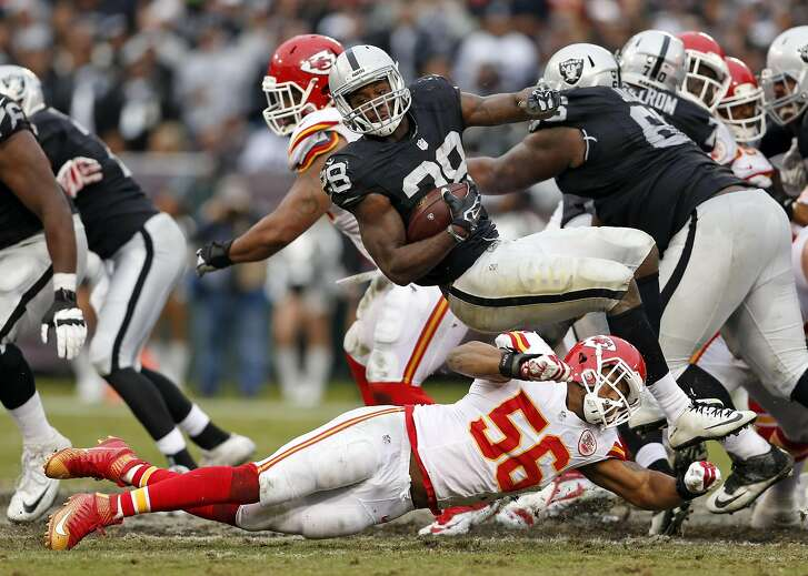 Oakland Raiders' Latavius Murray is tackled by Kansas City Chiefs' Derrick Johnson in 4th quarter during Kansas City's 34-20 win in NFL game at O.co Coliseum in Oakland, Calif., on Sunday, December 6, 2015.