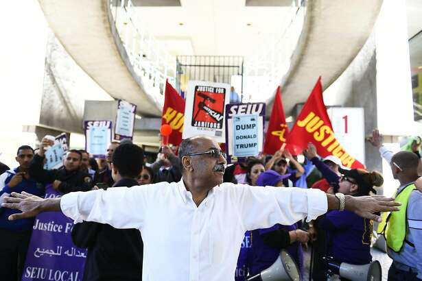 Ahmed Abozayd vice president of Local 87 holds marchers while police clear the street of cars during a march in support of janitors with SEIU Local 87 on Thursday, July 28, 2016 in downtown San Francisco. The janitors are in a contract fight with employers.