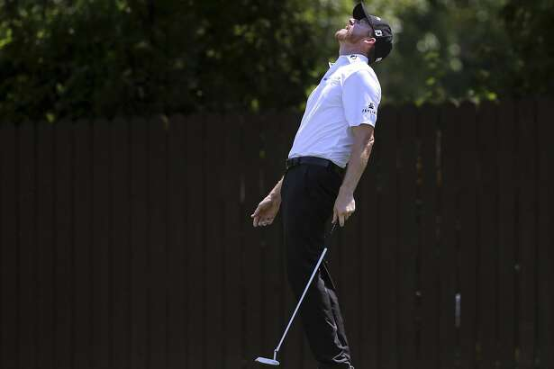 Jimmy Walker reacts to his putt on the seventh hole during the first round of the PGA Championship golf tournament at Baltusrol Golf Club in Springfield, N.J., Thursday, July 28, 2016. (AP Photo/Seth Wenig)