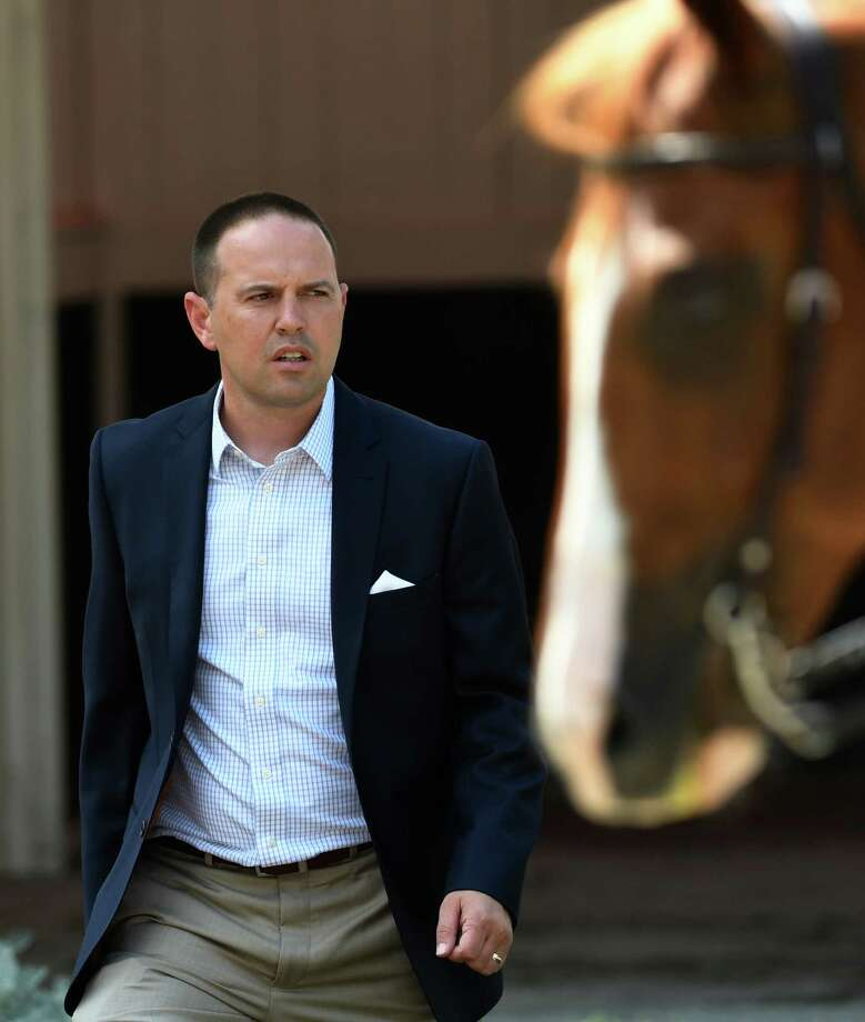 Trainer Chad Brown leaves the paddock after saddling his charge at the Saratoga Race Course Wednesday July 27, 2016 in Saratoga Springs, N.Y.  (Skip Dickstein/Times Union) Photo: SKIP DICKSTEIN
