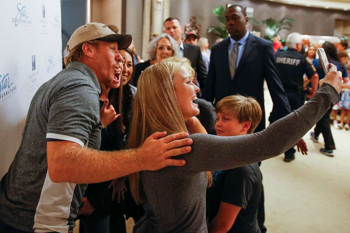 Chip and Joanna Gaines, from the HGTV show Fixer Upper, meet fans at Star Furniture to launch a new line of home furnishings Thursday, July 28, 2016 in Houston.