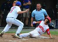 Fairfield American's Matt Vivona slides into home plate as Coginchaug's Jeremy Mangiameli tries to make the tag during Connecticut State Little League Championship action in Manchester, Conn. on Thursday July 28, 2016. Vivona was called safe. Fairfield American beat Coginchaug 6-2.
