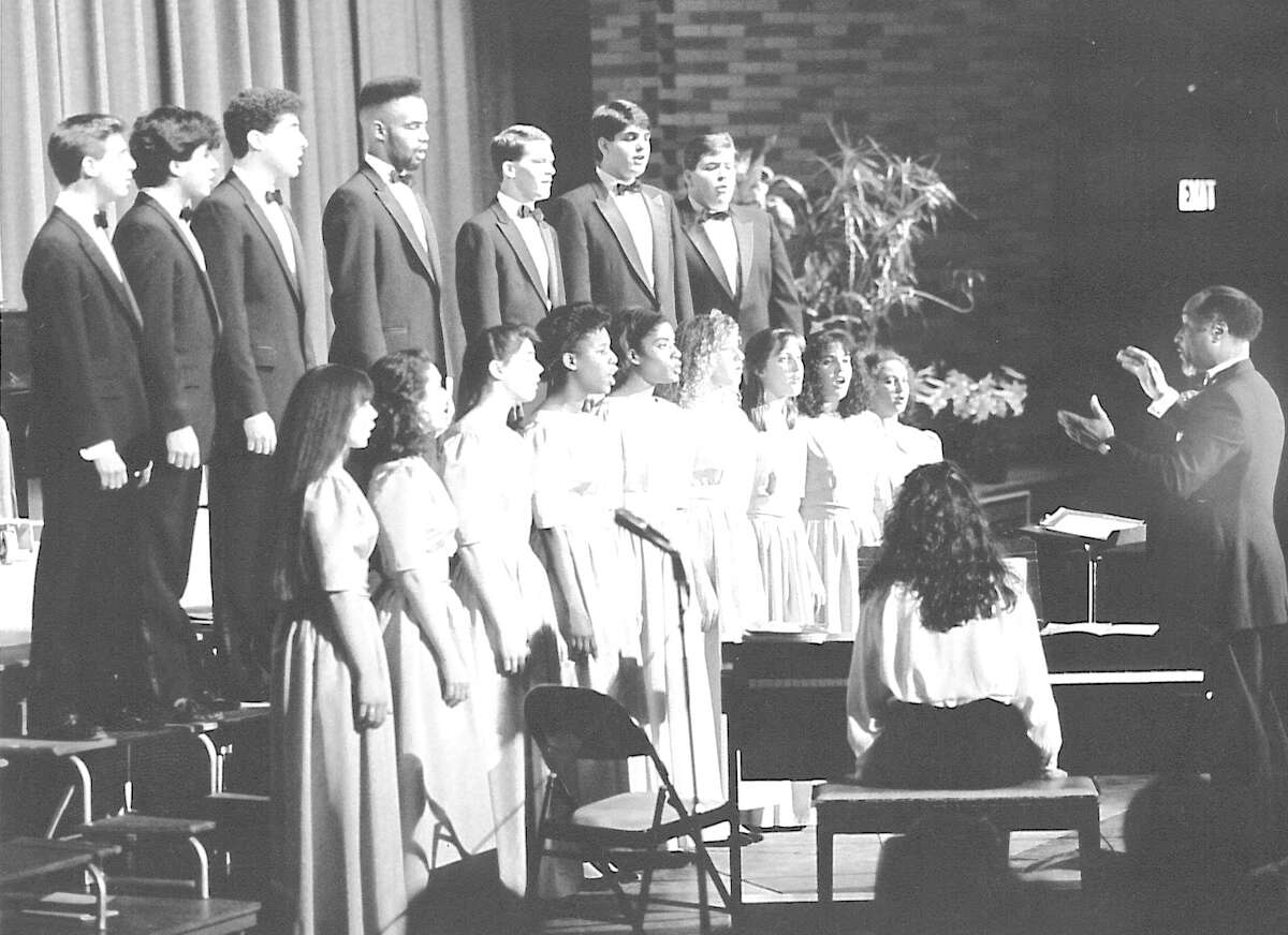 Jesse R. Chapman, music director and conductor of the Westhill Chamber Singers, leads the group in a concert on March 24, 1991.