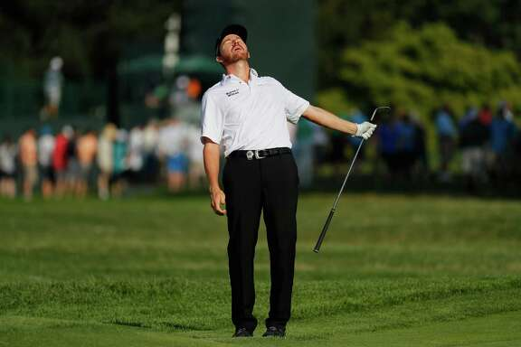PGA Championship leader Jimmy Walker just misses on a chip shot from off the green on the par-3 No. 12 hole Thursday. Walker went on to sink his par putt en route to shooting a 5-under-par 65.