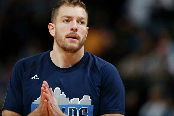 Dallas Mavericks forward David Lee warms up for an NBA basketball game on March 28, 2016, in Denver.