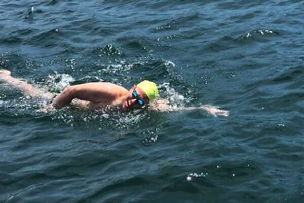 David Dammerman crossing the finish line after his 32.2-mile Lake George swim on June 19, 2016. (Courtesy of Bob Singer)