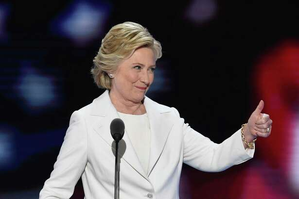 Democratic presidential nominee Hillary Clinton arrives on stage during the fourth and final night of the Democratic National Convention at Wells Fargo Center on July 28, 2016 in Philadelphia, Pennsylvania.   / AFP PHOTO / SAUL LOEBSAUL LOEB/AFP/Getty Images