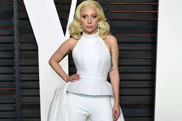 FILE - In this Feb. 28, 2016 file photo, Lady Gaga arrives at the Vanity Fair Oscar Party in Beverly Hills, Calif. One of the country's most impoverished cities will get some time in the Democratic convention spotlight Thursday, July 28, 2016, with some help from Lady Gaga. Thousands of convention delegates have been invited across the Delaware River to Camden for an afternoon concert with the pop star. (Photo by Evan Agostini/Invision/AP, File) ORG XMIT: CAET696