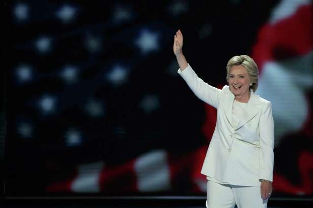 PHILADELPHIA, PA - JULY 28:  Democratic presidential nominee Hillary Clinton waves to the crowd as she arrives on stage during the fourth day of the Democratic National Convention at the Wells Fargo Center, July 28, 2016 in Philadelphia, Pennsylvania. Democratic presidential candidate Hillary Clinton received the number of votes needed to secure the party's nomination. An estimated 50,000 people are expected in Philadelphia, including hundreds of protesters and members of the media. The four-day Democratic National Convention kicked off July 25.  (Photo by Alex Wong/Getty Images) ORG XMIT: 655802163