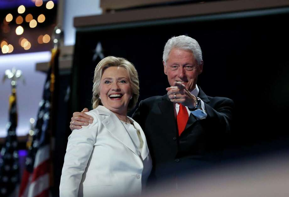 Democratic presidential nominee Hillary Clinton is joined by her husband Former President Bill Clinton after addressing the delegates during the final day of the Democratic National Convention in Philadelphia, Thursday, July 28, 2016. The couple is on a national speaking tour, with their next stop in Sugar Land on Tuesday. (AP Photo/Carolyn Kaster)