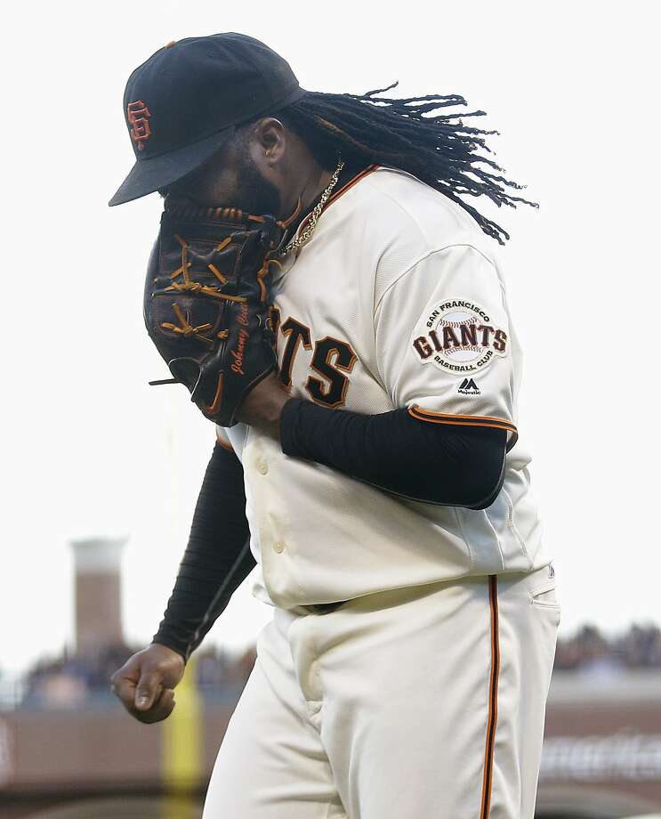 San Francisco Giants pitcher Johnny Cueto yells into his glove after Washington Nationals' Tanner Roark hit an RBI single during the second inning of a baseball game in San Francisco, Thursday, July 28, 2016. (AP Photo/Jeff Chiu) Photo: Jeff Chiu, Associated Press