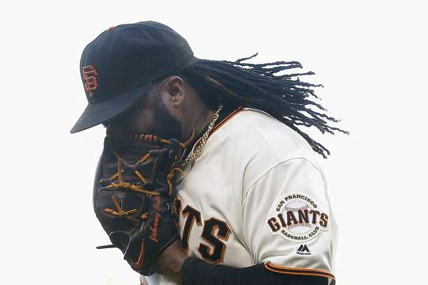 San Francisco Giants pitcher Johnny Cueto yells into his glove after Washington Nationals' Tanner Roark hit an RBI single during the second inning of a baseball game in San Francisco, Thursday, July 28, 2016. (AP Photo/Jeff Chiu)