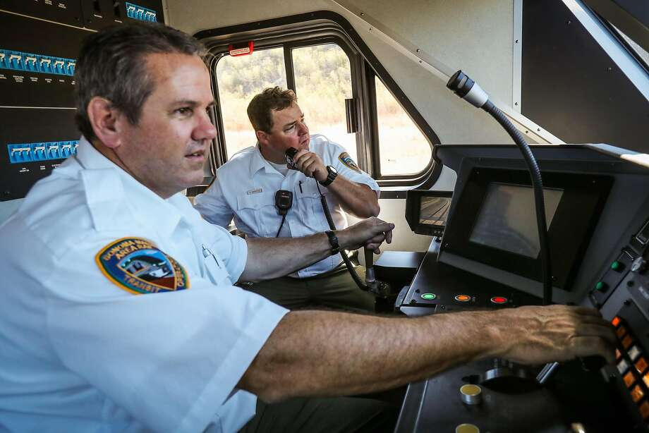 SMART train operators Vince Kerins (left) and Garrett Augustus prepare to take a new train out for a test ride in Petaluma. Photo: Gabrielle Lurie, Special To The Chronicle