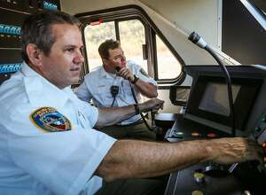 Smart train operators Vince Kerins (left) and Garrett Augustus (center) prepare to take a new train out for a test ride, in Petaluma, California, on Thursday, July 28, 2016.