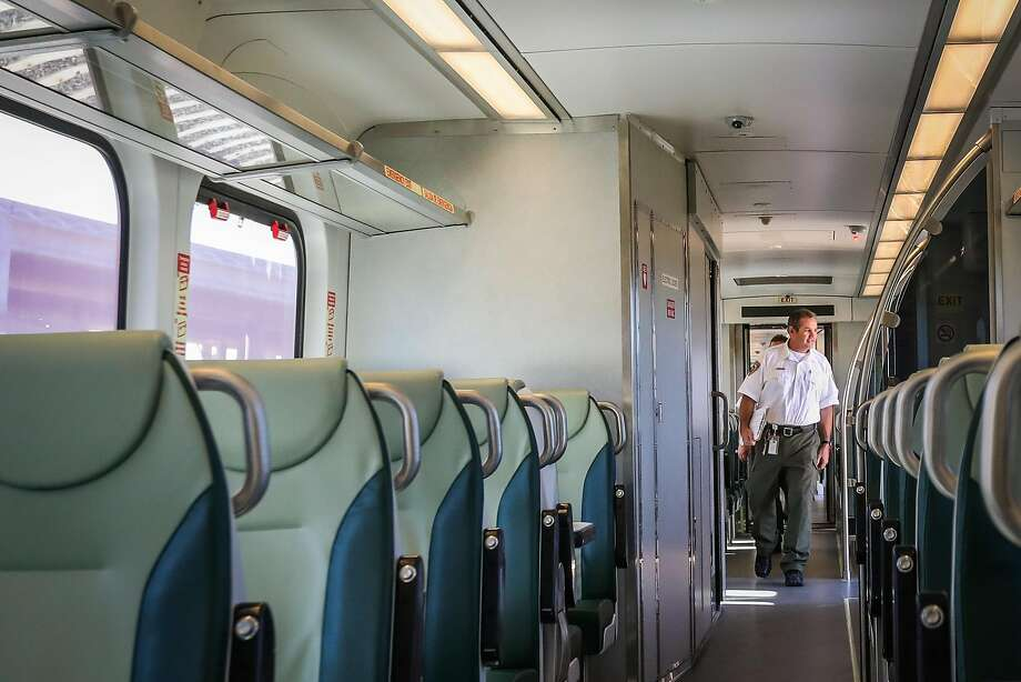 SMART train operator Vince Kerins walks through a new train before preparing it for a test ride in Petaluma in July. Photo: Gabrielle Lurie, Special To The Chronicle