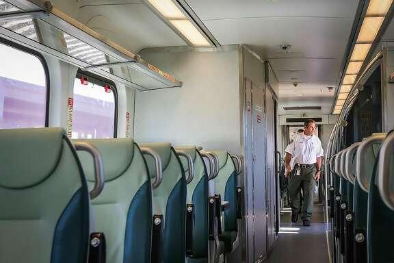 Smart train operator Vince Kerins walks through the corridor of a new train before preparing it for a test ride, in Petaluma, California, on Thursday, July 28, 2016.