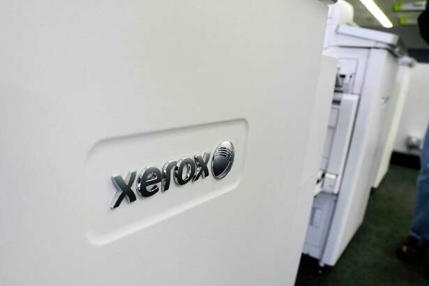 Xerox increased earnings in the second quarter of 2016, despite a 4 percent decline in revenue coupled with increased costs associated with its spinoff of Conduent. (AP Photo/Elise Amendola)