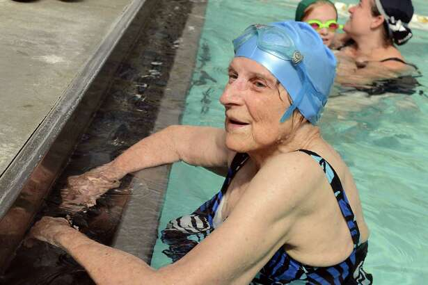 Margaret Wachs celebrates her 100th birthday with a 1/4 mile swim as a fundraiser for the Stratford United Methodist Church Friday, Sept. 20, 2013 at the Woodruff Family YMCA in Milford, Conn. Her funeral will take place on Saturday, July 30, 2016.