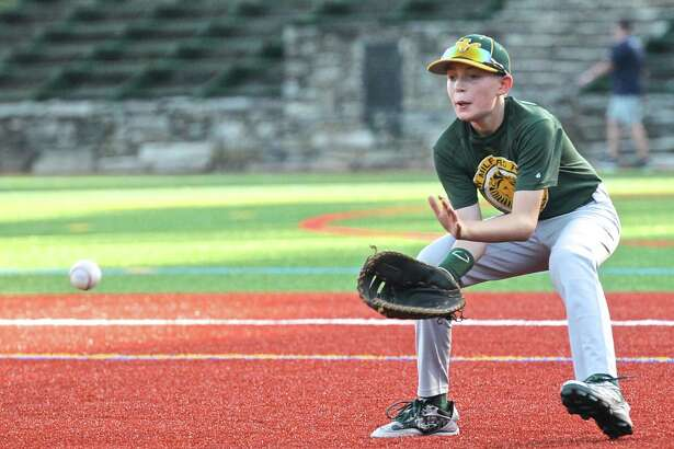 New Milford's Justin LeClair fields a ground ball during a Cal Ripken 12/70 baseball team practice Wednesday at The Gunery School in Washington. The team will play in the Cal Ripken World Series beginning Saturday in Aberdeen, Md.