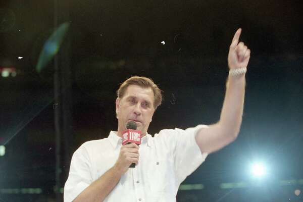 06/23/1994 - Houston Rockets at their sold-out victory party in the Astrodome Thursday night, June 23, 1994. Rockets coach Rudy Tomjanovich speaks to the nearly 52,000 fans celebrating the Houston Rockets' victory over the New York Knicks for the National Basketball Association championship. Â Houston Chronicle
