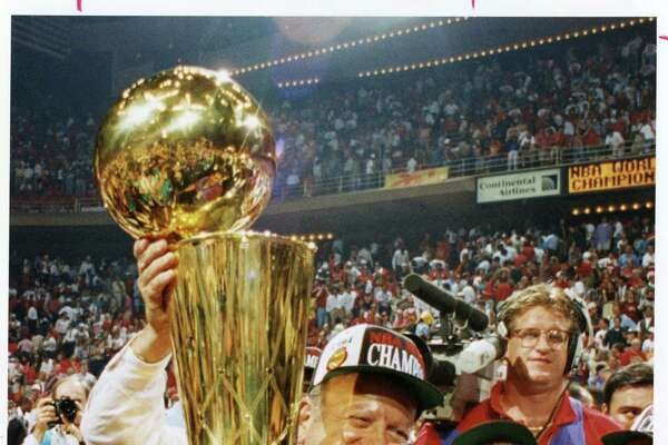 Owner Leslie Alexander clutches the trophy after the Rockets beat the Knicks in 1994 for the title.