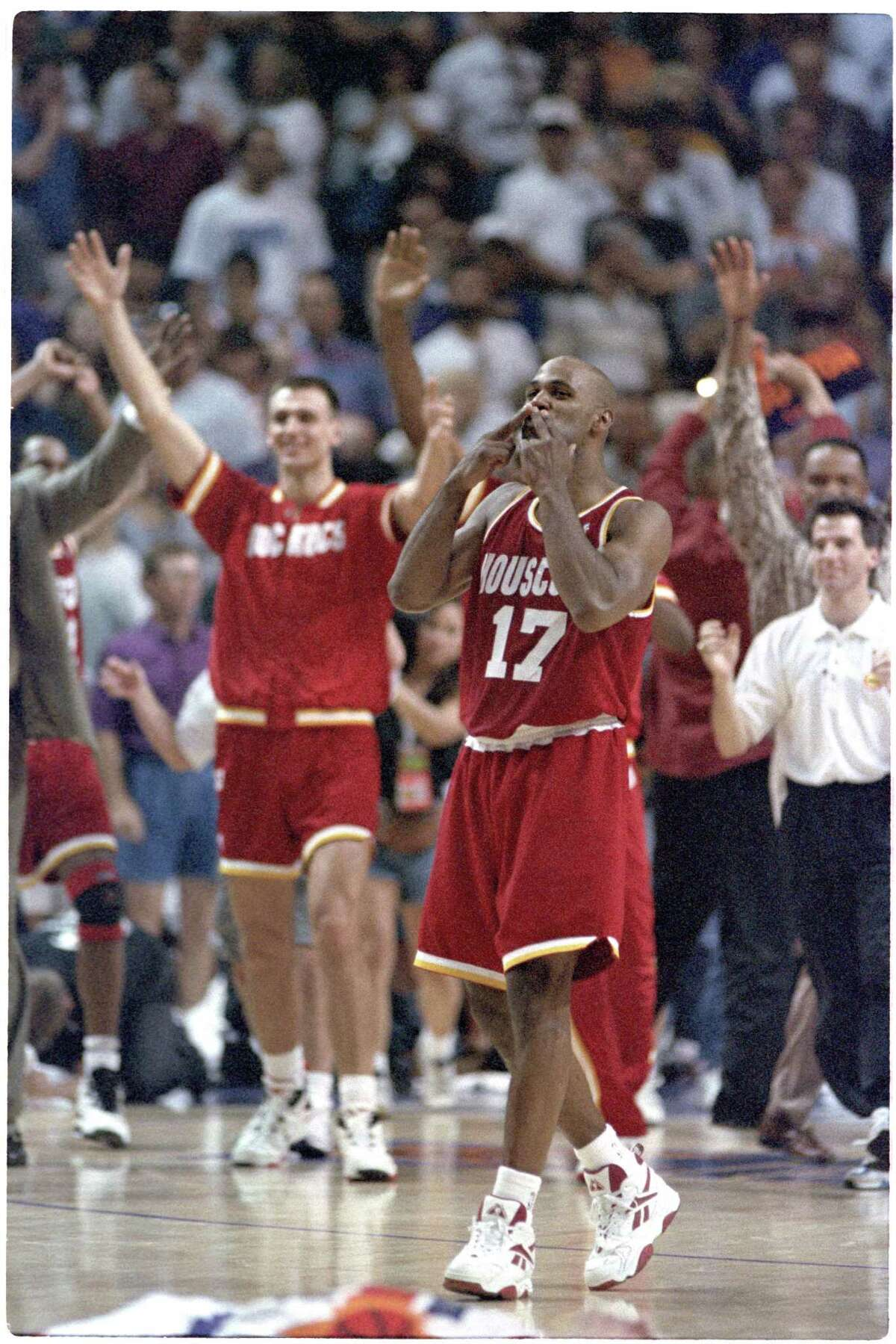 Mario Elie blows the 'Kiss of Death' to the Phoenix bench after his go-ahead 3-pointer during the final seconds of Game 7 of the 1995 Western Conference semifinals May 20, 1995, at American West Arena in Phoenix. Click through the gallery to relive other memorable moments from the Rockets' two championship runs.