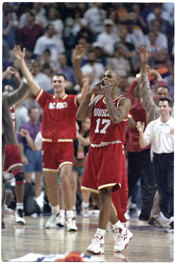 Mario Elie blows the 'Kiss of Death' to the Phoenix bench after his go-ahead 3-pointer during the final seconds of Game 7 of the 1995 Western Conference semifinals May 20, 1995, at American West Arena in Phoenix.  Click through the gallery to relive other memorable moments from the Rockets' two championship runs. Photo: Richard Carson, HC Staff / Houston Chronicle