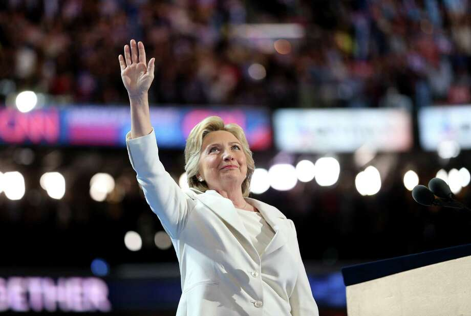 Hillary Clinton waves while arriving on stage during the Democratic National Convention in Philadelphia, on Thursday, when she became the first woman to accept the nomination of a major party in the United States. Photo: Daniel Acker /Bloomberg / © 2016 Bloomberg Finance LP