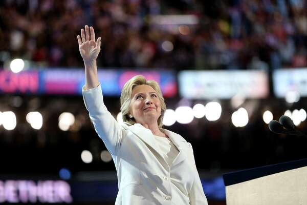 Hillary Clinton waves while arriving on stage during the Democratic National Convention in Philadelphia, on Thursday, when she became the first woman to accept the nomination of a major party in the United States.