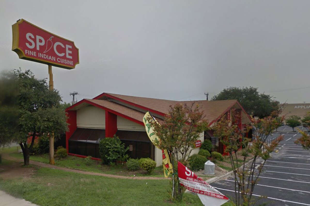 Spice Fine Indian Cuisine: 4987 Loop 410 NW, San Antonio, TX 78229 Date: 05/11/2018 Score: 70 Highlights: Inspector observed Food debris throughout entire kitchen floor, under all shelves, behind appliances, on walls, in dry storage space, on all equipment, and inside refrigerating units such as cold hold and walk in cooler shelves. Moldy nozzles at soda fountain station. Worn out cutting boards. Food debris accumulation on food shelves in walk in cooler. Rusting shelves with paint scraped off. No soap at their only hand sink in kitchen. Cold hold unit directly in front of stove not working properly. Several water bottles (personal drinks) throughout kitchen, on prep tables and other working areas. Proper thawing method for raw chicken not being practiced. Wiping towels out on prep tables. Can of Raid on shelf above food prep table.