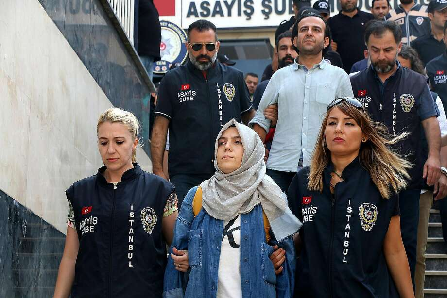 Police escort journalists to court, in Istanbul, Friday, July 29, 2016. Twenty-one journalists were appearing in court after being detained as part of a sweeping crackdown following Turkey's July 15 failed military coup, while the country's Ministry of European Union Affairs suspended several staff. (Ali Aksoyer/DHA via AP) Photo: DHA, Associated Press