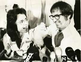 Billie Jean King and Bobby Riggs at a press conference announcing their 1973 tennis match.     Ran on: 08-14-2005 Billie Jean King and Bobby Riggs arm wrestle at a press conference announcing their 1973 match.