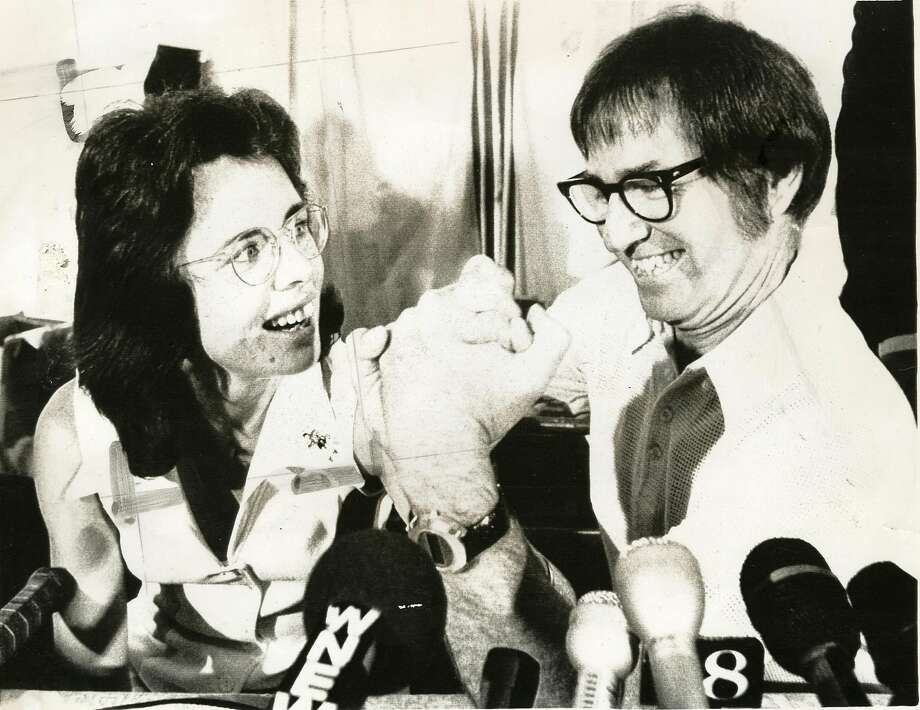 Billie Jean King and Bobby Riggs at a press conference announcing their 1973 tennis match.     Ran on: 08-14-2005 Billie Jean King and Bobby Riggs arm wrestle at a press conference announcing their 1973 match. Photo: UPI