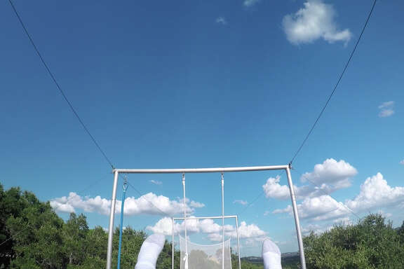 The view from a camera mounted on 9-year-old Sammy Penner as he flies on the trapeze at Hidden Hills Arts in the Texas Hill Country.