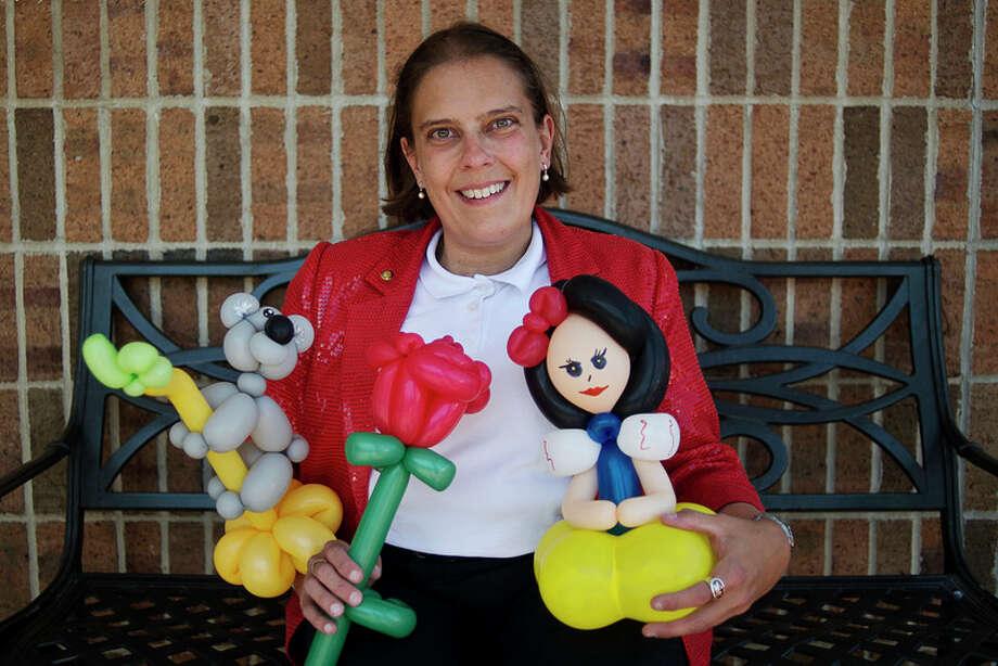 ERIN KIRKLAND | ekirkland@mdn.net Balloon artist Carrie Rostollan poses with a few of her creations.