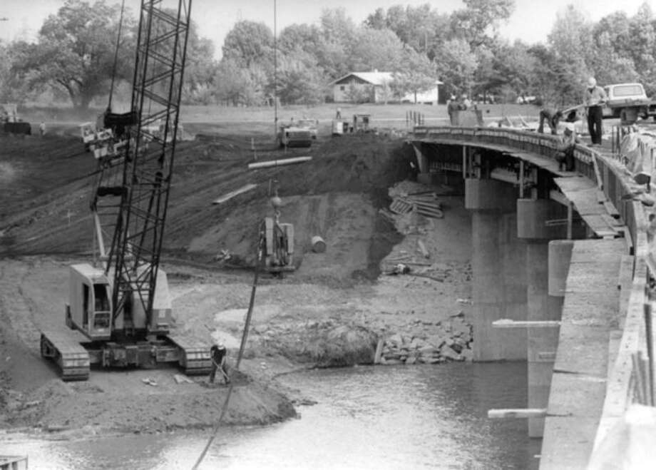 Daily News file photo Work on the new bridge across the Tittabawassee River north of Mapleton is seen in these Oct. 7, 1975, photos.