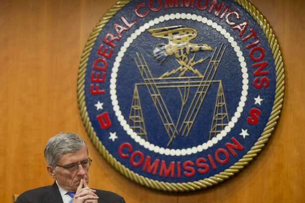 """In this Thursday, Feb. 26, 2015, file photo, Federal Communications Commission (FCC) Chairman Tom Wheeler listens to commissioners speak prior to a vote on Net Neutrality, at the FCC in Washington. The FCC issuing """"net neutrality'' rules designed to bar Internet service providers from offering preferential treatment to sites that pay for faster service, was one of The Associated Press' top stories in 2015. (AP Photo/Pablo Martinez Monsivais, File)"""