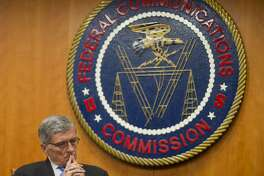 "In this Thursday, Feb. 26, 2015, file photo, Federal Communications Commission (FCC) Chairman Tom Wheeler listens to commissioners speak prior to a vote on Net Neutrality, at the FCC in Washington. The FCC issuing ""net neutrality'' rules designed to bar Internet service providers from offering preferential treatment to sites that pay for faster service, was one of The Associated Press' top stories in 2015. (AP Photo/Pablo Martinez Monsivais, File)"