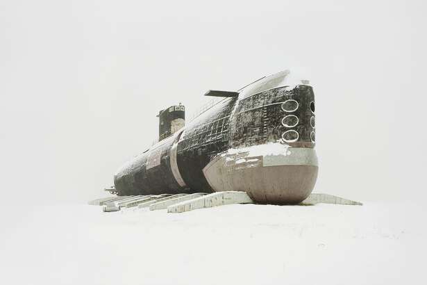 World's largest diesel submarine.   Photographer Danila Tkachenko traveled thousands of miles in search of these abandoned sites, which used to house great technological progress in the former Soviet Union. Tkachenko's photos will be featured as a par of European Month of Photography in Berlin this September.