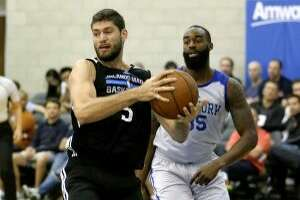 Orlando Magic White's Patricio Garino, left, grabs a rebound in front of New York Knicks' DaJuan Summers during the first half of an NBA summer league basketball game, Wednesday, July 6, 2016, in Orlando, Fla. (AP Photo/John Raoux)