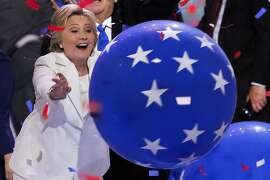 Democratic presidential nominee Hillary Clinton reaches for a falling balloon at the conclusion of the Democratic National Convention in Philadelphia , Thursday, July 28, 2016. (AP Photo/J. Scott Applewhite)