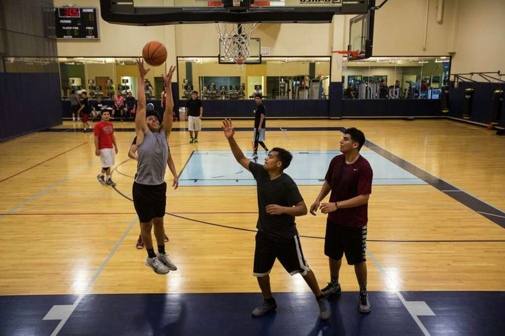 At south side gym basketball becomes game of life san antonio young men play a game of pickup basketball at centro fitness photo brittany greeson altavistaventures Gallery