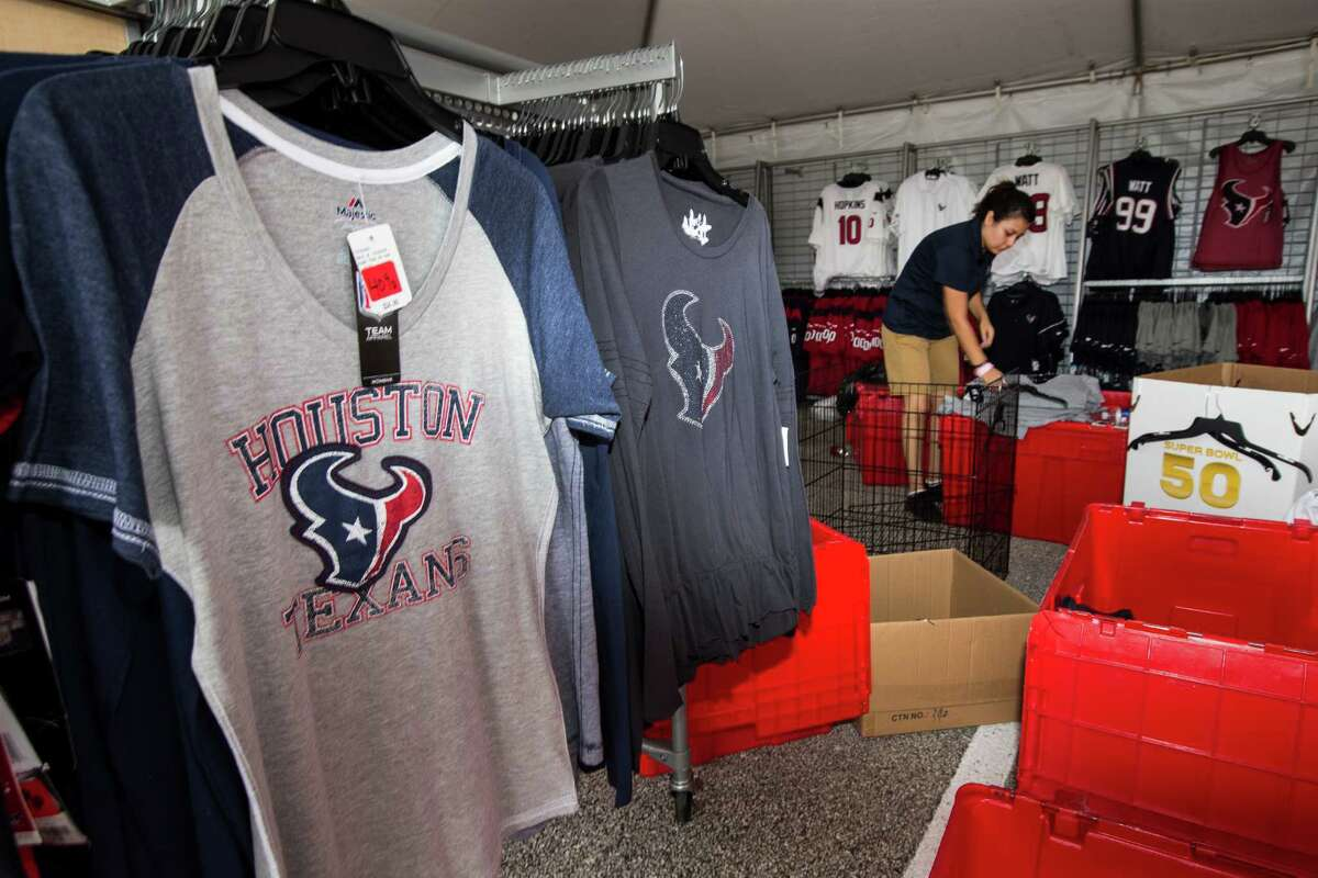 Clara Cardenas, of the Go Texans store, sets up an apparel booth while setting up at the Methodist Training Center facility for Houston Texans Training Camp on Friday, July 29, 2016, in Houston. The Texans open training camp on Sunday.