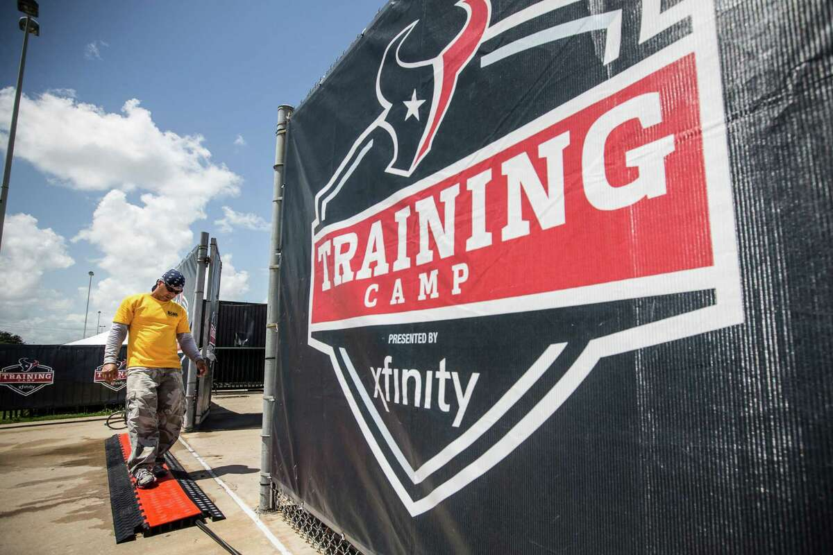 Rudy Hernandez lays down water and electricity lines while setting up the Methodist Training Center facility for Houston Texans Training Camp on Friday, July 29, 2016, in Houston. The Texans open training camp on Sunday.